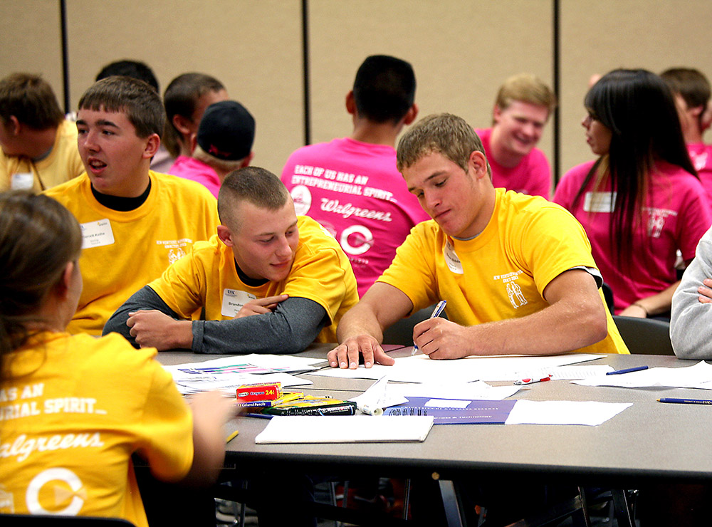 At New Venture Adventure, UNK students coach high school students to develop business proposals that are presented to area business leaders at the end of the daylong event. (Photo by Sara Giboney/UNK News)