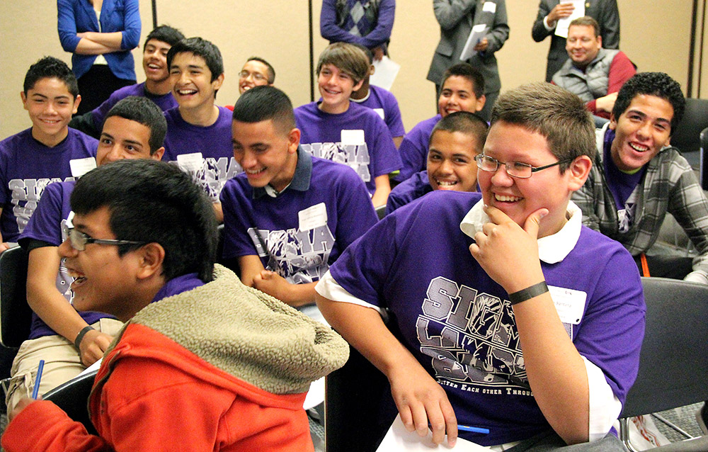 Students react to a presentation on bullying at the first BETA-Men Youth Empowerment Conference at UNK. The event focused on topics such as bullying, sports, relationships and self image. (Photo by Adrianna Tarin/UNK News)