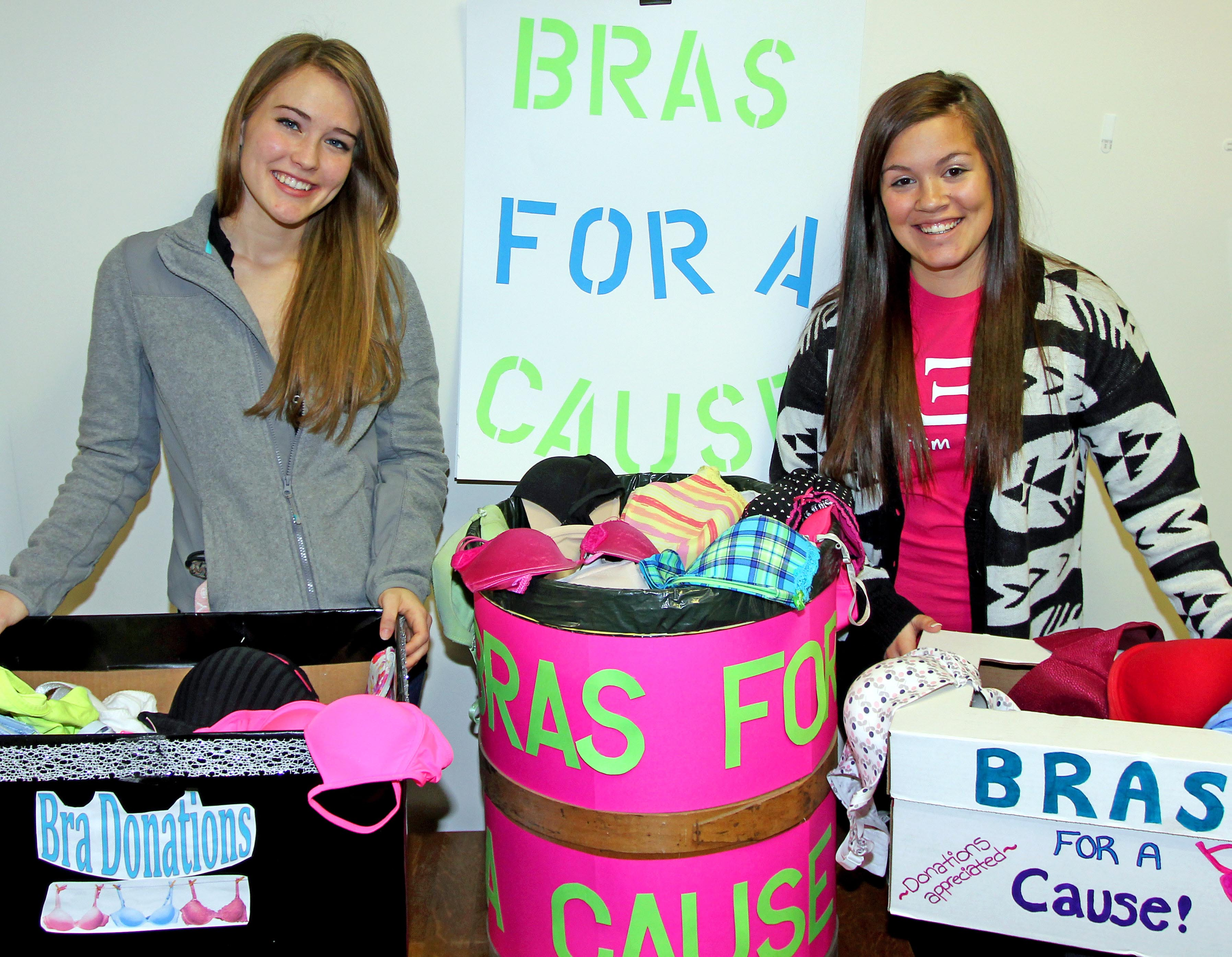 UNK students Ashley Nielsen, left, of Gering and Megan Rash, right, of Kearney are among those collecting gently used bras for Free the Girls, a nonprofit that provides women rescued from sex trafficking an opportunity to earn a living by selling used clothing. (Photo by Todd Gottula/UNK News)