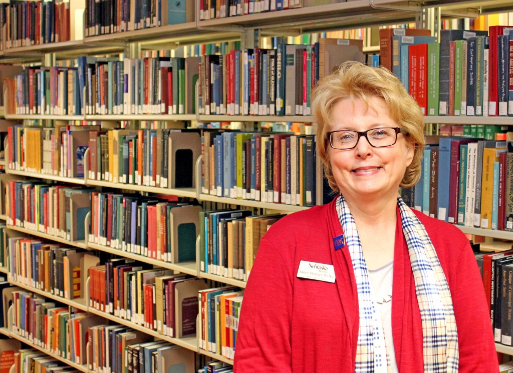 "More than 7,000 books were damaged in April when part of the roof was torn off the Calvin T. Ryan Library at UNK. Janet Stoeger Wilke, dean of the library, is spearheading efforts to raise money needed to replace the books through the ""Buy a Book for the Library"" program. (Photo by Todd Gottula/UNK News)"