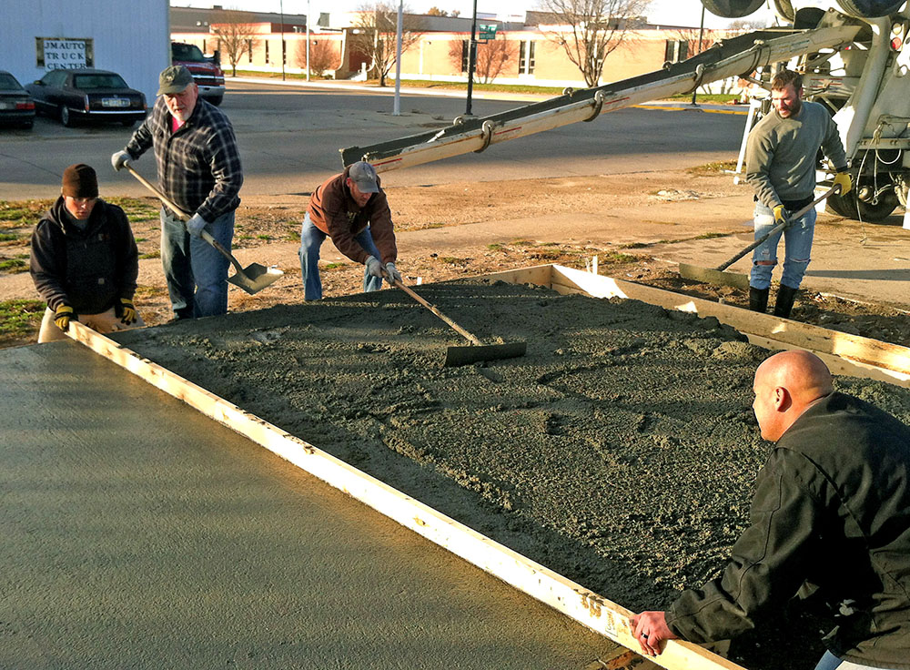 Construction Management Organization members at the University of Nebraska at Kearney build a garage for Boy Scout Troop 158 in Kearney. The building will store the troop's camping gear and other supplies.