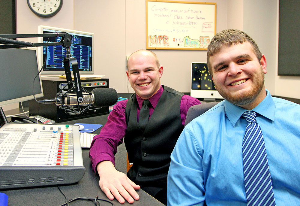 KLPR radio's John McDermott, left, and Bryce Dolan, right, teamed with Patrick Harris (not pictured) to win first place in the Best Talk Program category of the Intercollegiate Broadcasting System's Golden Microphone Awards. (Photo by Todd Gottula/UNK Communications)