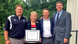 Barb Estes was given the the University of Nebraska Board of Regents KUDOS award on July 18. Attending the presentation were her sons (left to right) Luke, Erik and Aaron.