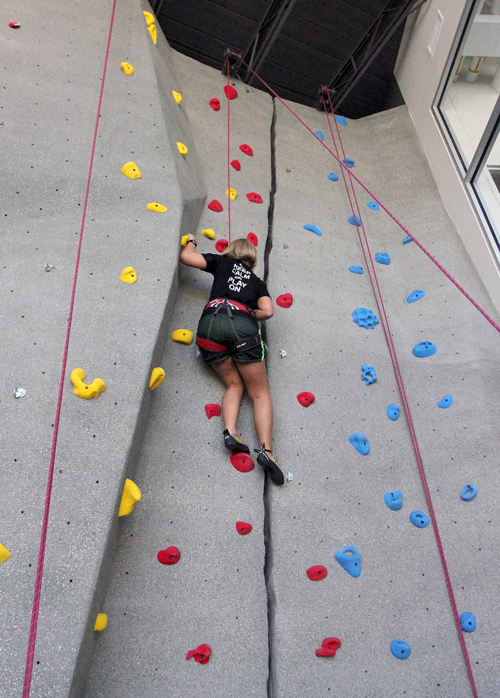 UNK student Erin Nelson makes her way up the new 30-foot rock climbing wall, which is part of the student fitness area inside the Wellness Center. (Photo by Todd Gottula/UNK Communications)