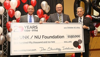 Intellicom Computer Consulting CEO Dan Shundoff, left, presents a check to UNK Dean of College of Business and Technology Tim Burkink, middle, and the NU Foundation's Pete Kotsiopulos at Intellicom's 20th anniversary celebration. Intellicom's contributions are valued at $150,000 and involve a multiyear partnership with UNK's College of Business and Technology to provide financial support, donated equipment for teaching laboratories and industry guidance for students.