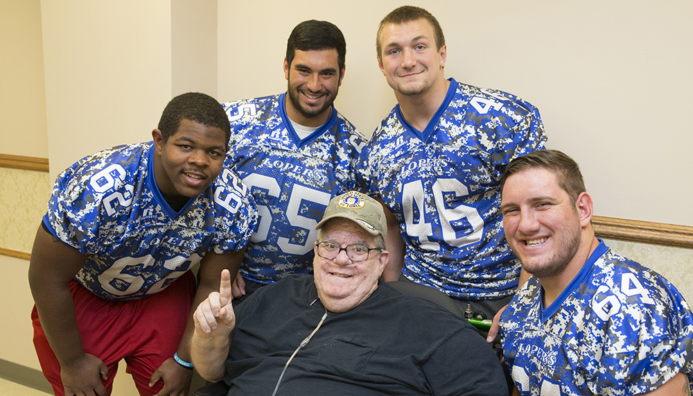 It was all smiles for Mike Nieting (center) at the Nebraska Veteran's Home in Grand Island Monday afternoon. Members of the University of Nebraska-Kearney football team visited the facility and enjoyed time with the residents and shared their appreciation for their service. Athletes partaking in the effort included (back from left) Chance Redmond, Jonathan Gula, Corey Van Dorn and Cole Manhart.