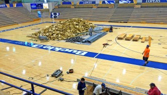 Workers remove the old bench-style seating at UNK's Health and Sports Center to make way for new chair back seating that is being installed. The $700,000 project will be finished in mid-August.