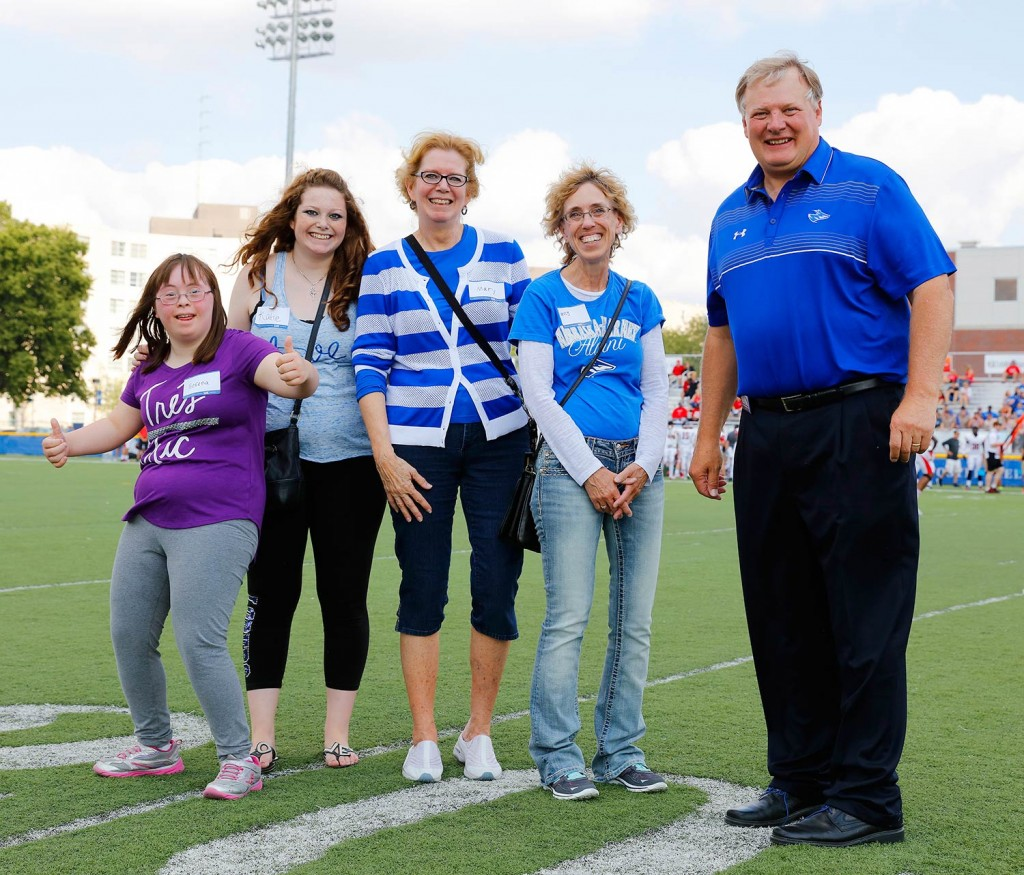 The Kovanda family of Grand Island is UNK's Outstanding Family Award winner for 2015. Katie Kovanda, second from left, and her mother Mary, third from left, were honored by UNK Chancellor Doug Kristensen at Saturday's Loper football game. Also pictured are the Kovanda's friends Nancy Chavez of Grand Island and her daughter, Serena, far left.
