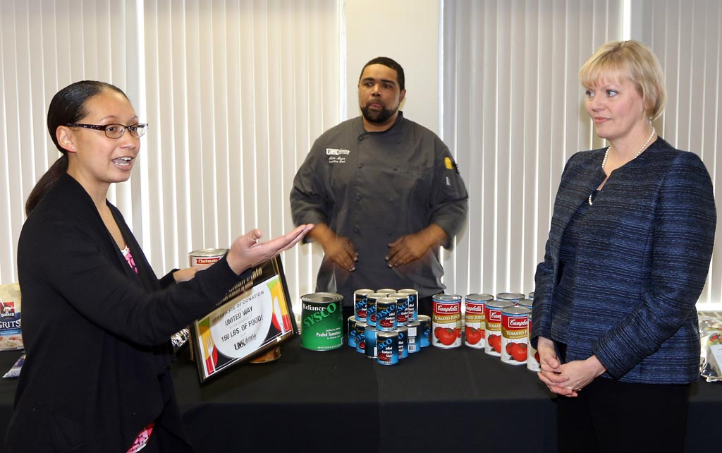 UNK Dining Services Marketing Manager Shonna King, left, presents 150 pounds of food to Lisa Reese Parish, executive director for United Way of the Kearney Area.