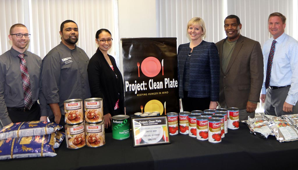UNK Dining Services donated 150 pounds of food to United Way of the Kearney area through its Project: Clean Plate program. Those participating in the recognition event Monday included, left to right: Scott Benson, Business and Finance; Alvin Mayes, executive chef; Shonna King, Dining Services; Lisa Reese Parish, United Way of the Kearney Area; Wil Smith, Dining Services; and Paul Plinske, UNK Athletics.