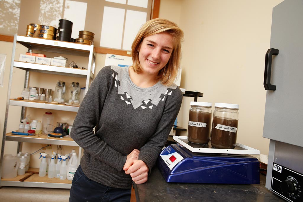 "Ashley Larsen, a senior geography major from Lexington, found organic rich, dark sediment in core samples collected as part of her work with geography professor Jeremy Dillon. The macrofossils, taken from 27 feet below the ground's surface, contained spruce needles and wood fragments. ""We have strong evidence to suggest that there was a wetland along Cherry Avenue surrounded by spruce forest. It would have looked similar to northern Minnesota or Canada,"" said Dillon."