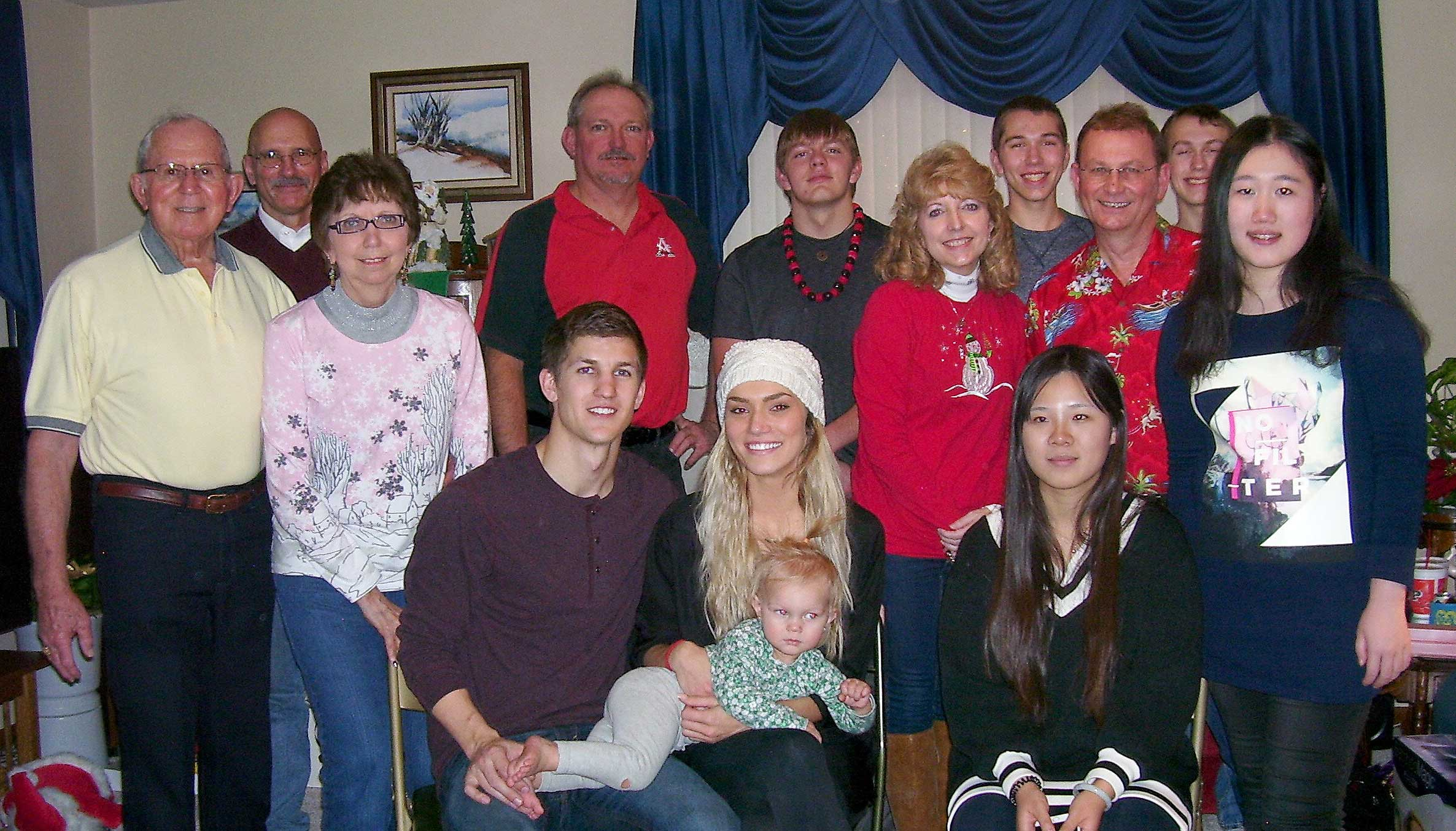 """Don and Jodi Daily, far left, of Kearney have been involved with the International Friendship Program at UNK for over six years. They typically invite their students over for dinner, play games at their home, celebrate holidays together and invite the students to family reunions. UNK students Ruinan """"Yanci"""" Yu and Naidan Zhang of China (far right) spent the holidays with the Daily family this year."""