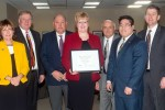 Fauneil Meier, middle, was recognized and given the KUDOS award Friday at the Board of Regents meeting, which was attended by (left to right) Assistant Vice Chancellor for Business and Finance Jane Sheldon, UNK Chancellor Doug Kristensen, husband Jim Meier, Regent Kent Schroeder, student Regent Evan Calhoun and NU President Hank Bounds.