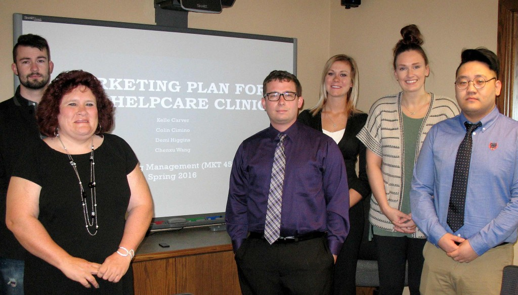 HelpCare's Garrett Vetter and Cheryl Bressington, far left, worked with UNK students, left to right, Colin Cimino of Kearney, Demi Higgins of Bennington, Kelle Carver of Shawnee, Kan., and Chenxu Wang of China in developing a marketing plan for the free clinic.