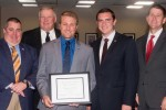 Brad Green, middle, was recognized and given the KUDOS award at Friday's Board of Regents meeting, which was attended by left to right: UNK Director of Admissions Dusty Newton, UNK Chancellor Doug Kristensen, UNL Student Regent Spencer Hartman and NU President Hank Bounds.