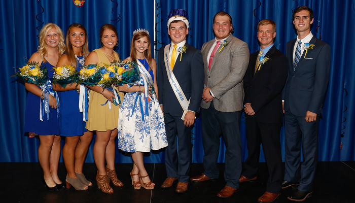 UNK Homecoming court, left to right: Courtney Hayden, Carlie Prososki, McKenzie Cuba, Lainey Russell, Luke Grossnicklaus, Sam Stoltenberg, Michael Wiese and Greg Christen.