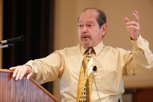 "Keynote presenter Ruben Rosario, columnist at the St. Paul Pioneer Press, presents ""Criminal Justice and the Media."""