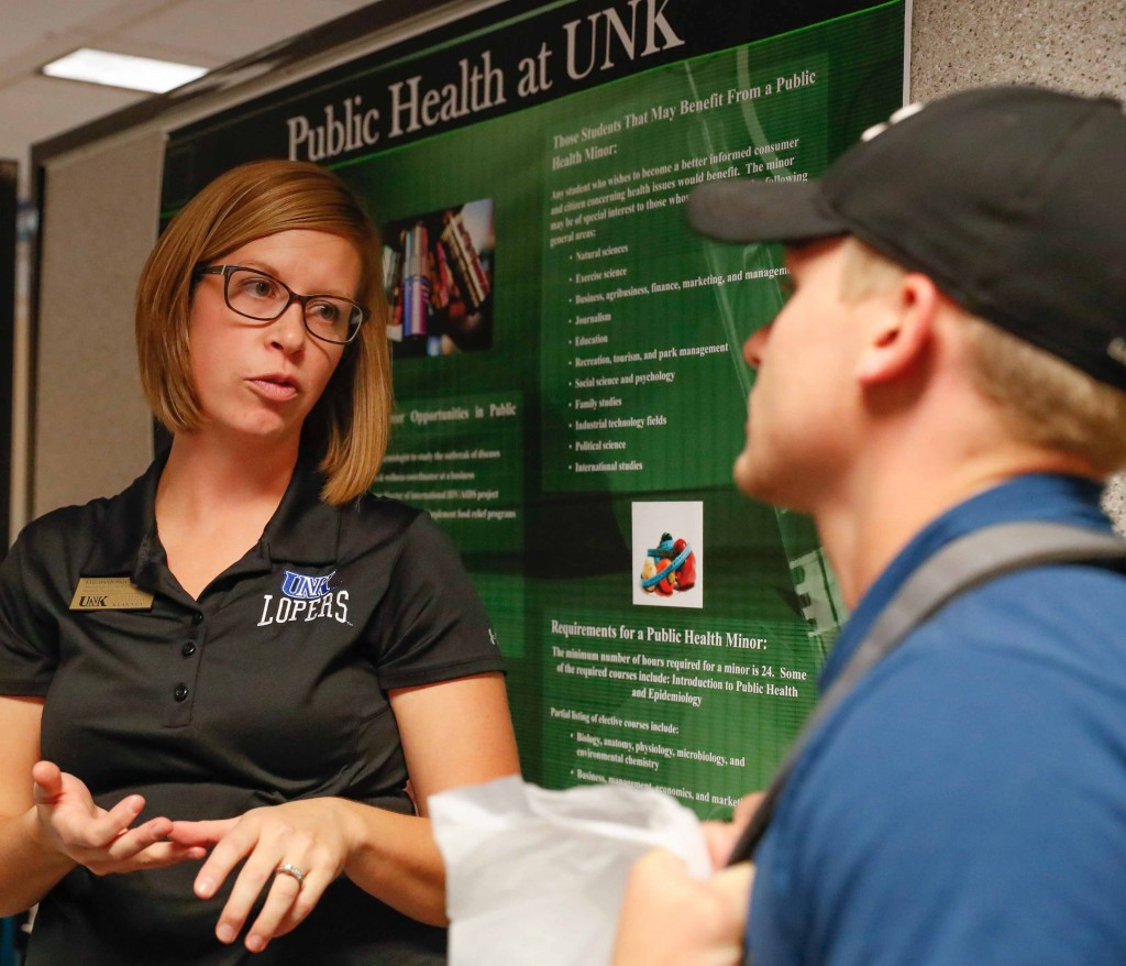 UNK Assistant Director of Health Sciences Elizabeth Stout, left, speaks with Tyan Boyer, a UNK pre-physical therapy major from Plainview at the recent Health Careers Fair. (Photo by Corbey R. Dorsey/UNK Communications)