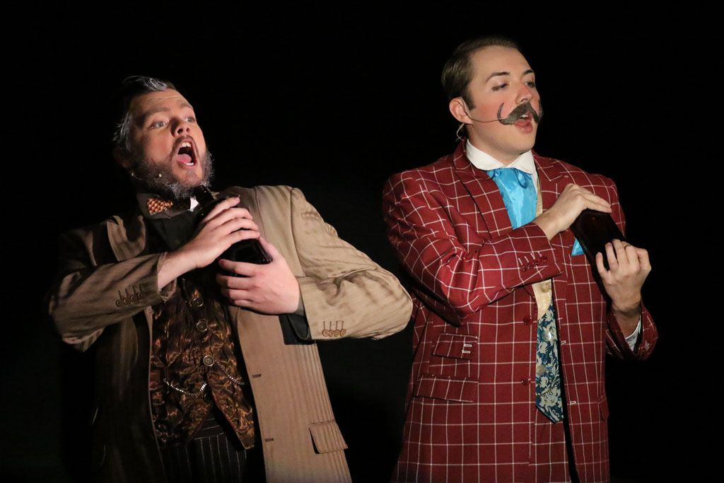"Nathaniel Baldwin of Ogallala, playing Tiger Brown, and Tanner Peshek of Hastings, playing Macheath, perform a scene from ""The Threepenny Opera."" The University of Nebraska at Kearney production runs Wednesday through Sunday at Miriam Drake Theatre. (Photo by Corbey R. Dorsey/UNK Communications)"