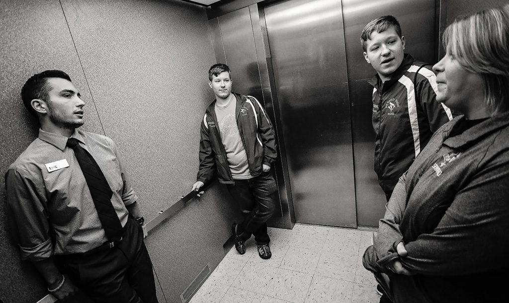 10:47 a.m. - Suzanne Gligorevic and her sons discuss UNK on an elevator ride with student diplomat Frank Cuddy.
