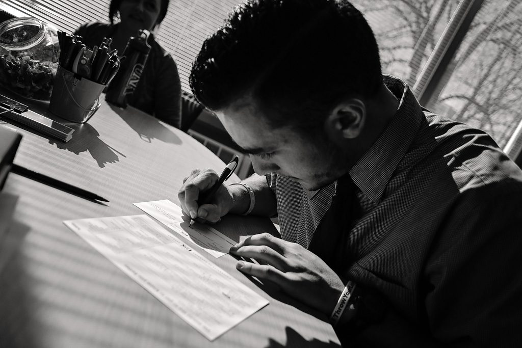 11: 30 a.m. - UNK student diplomat Frank Cuddy of Lincoln writes thank you notes to those who took campus tours that day.