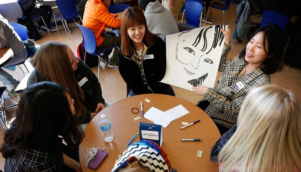 UNK students in the English Language Institute participate in a recent Campus Conversation Table, which helps international students practice their English speaking, writing, reading and listening skills. (Photo by Corbey R. Dorsey/UNK Communications)