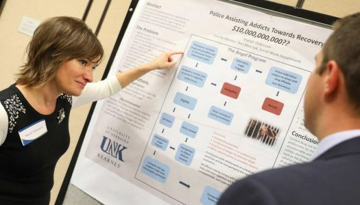 "Sherah Dickinson of Grand Island presents her research, ""Police Assisting Addicts Towards Recovery,"" at UNK's Fall Student Research Symposium. Dickinson is among 25 UNK students selected to participate in the esteemed National Conference on Undergraduate Research in Memphis April 6-8. (File photo by Corbey R. Dorsey/UNK Communications)"