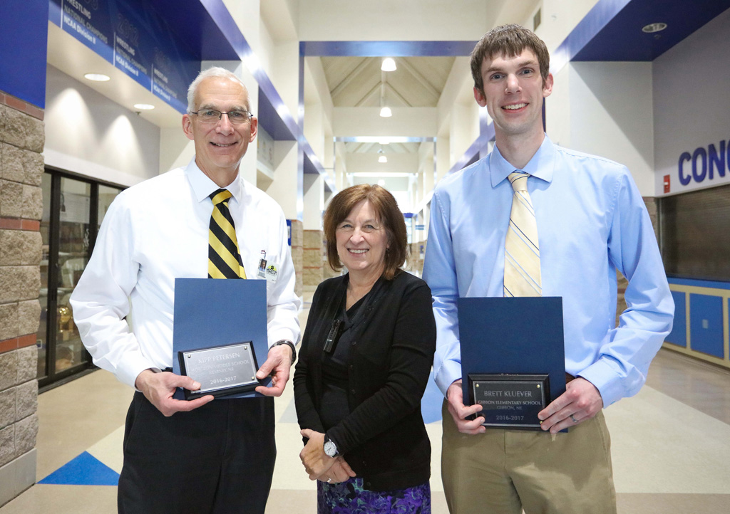 UNK College of Education Dean Sheryl Feinstein recognized Kipp Petersen, left, and Brett Kluever, right, for their work with UNK students entering the education profession. Petersen and Kluever were each inducted into UNK's Academy for Teacher Education Excellence.