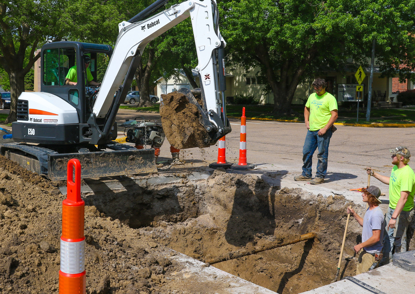 Myers Construction of Broken Bow workers dig up concrete near campus to prepare for installation of a new fiber ring network. (Photo by Corbey R. Dorsey/UNK Communications)