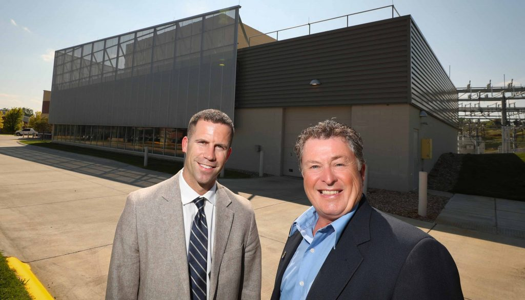 UNK soon will get 25 percent of its electrical energy from the new SoCore Energy solar park being built in Kearney. UNK's Jon Watts, left, and NPPD's Stan Clouse worked on the agreement, which is part of the university's sustainability plan. (Photo by Corbey R. Dorsey/UNK Communications)