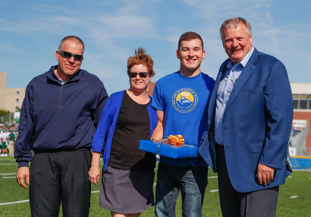 The University of Nebraska at Kearney named the Grossnicklaus family of Aurora as its Outstanding Family Award winner for 2017. Chancellor Doug Kristensen, far right, recognized UNK senior Luke Grossnicklaus and his parents, Kelly and Karen, at Saturday's Loper football game. (Photo by Corbey R. Dorsey, UNK Communications)