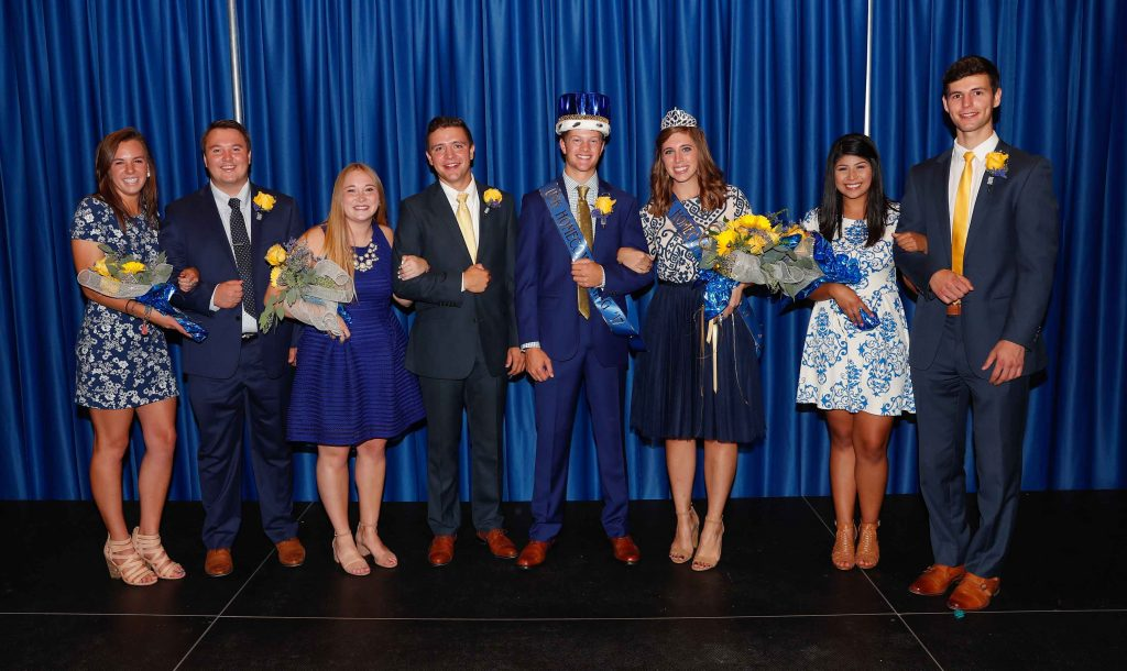 UNK Homecoming royalty candidates included, left to right: Kylie Kenedy of Omaha, Taylor Janicek of Bridgeport, Ivy Prater of Elgin, Alex Hart of Lynch, King Logan Krejdl of Aurora, Queen Miranda Ketteler of Petersburg, Odalys Cruz of Schuyler and Austin Partridge of Grand Island.