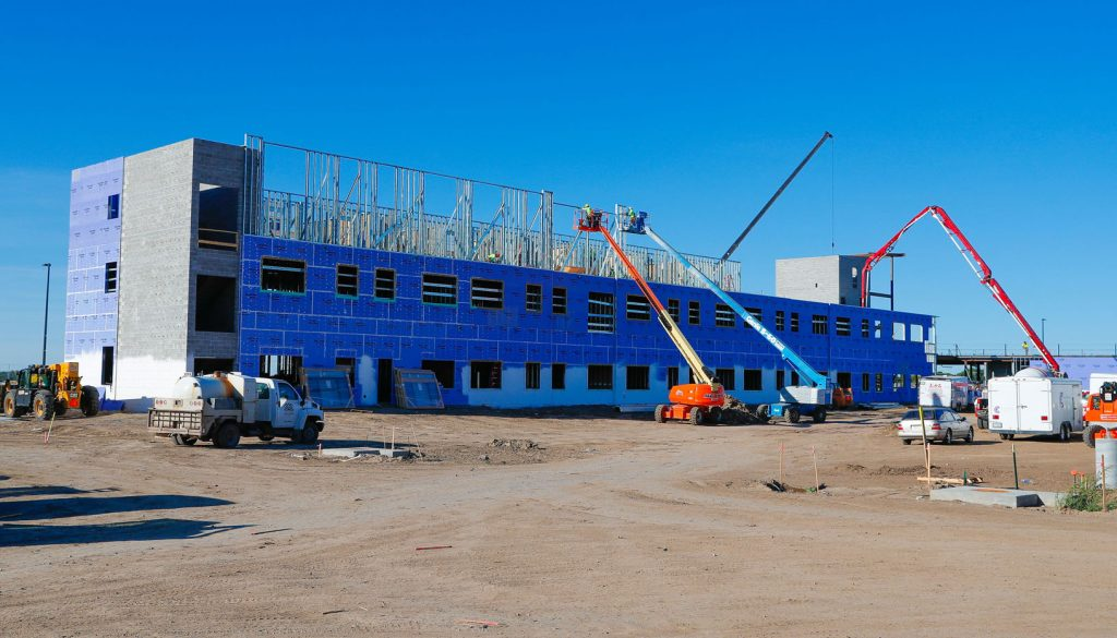 Crews frame UNK's $16 million Village Flats residence hall south of campus. The three-story structure includes 99 suites and 130 beds. (Photo by Corbey R. Dorsey, UNK Communications)