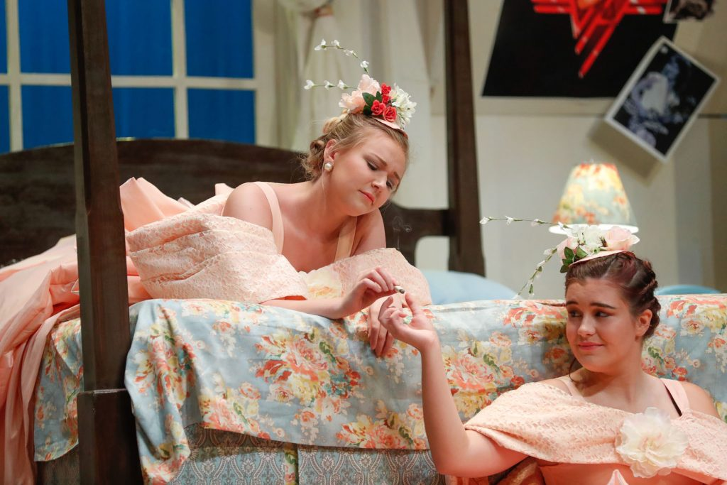 "Trisha Miller of Lincoln, left, and Megan Hayhurst of Scottsbluff rehearse a scene from ""Five Women Wearing the Same Dress."" The show runs Wednesday through Sunday at University of Nebraska at Kearney's Miriam Drake Theatre. (Photo by Corbey R. Dorsey, UNK Communications)"