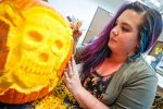 University of Nebraska at Kearney student Autumn Castellanos of Cozad carves a pumpkin Monday for an annual contest on campus among fine arts students and others. (Photo by Corbey R. Dorsey, UNK Communications)