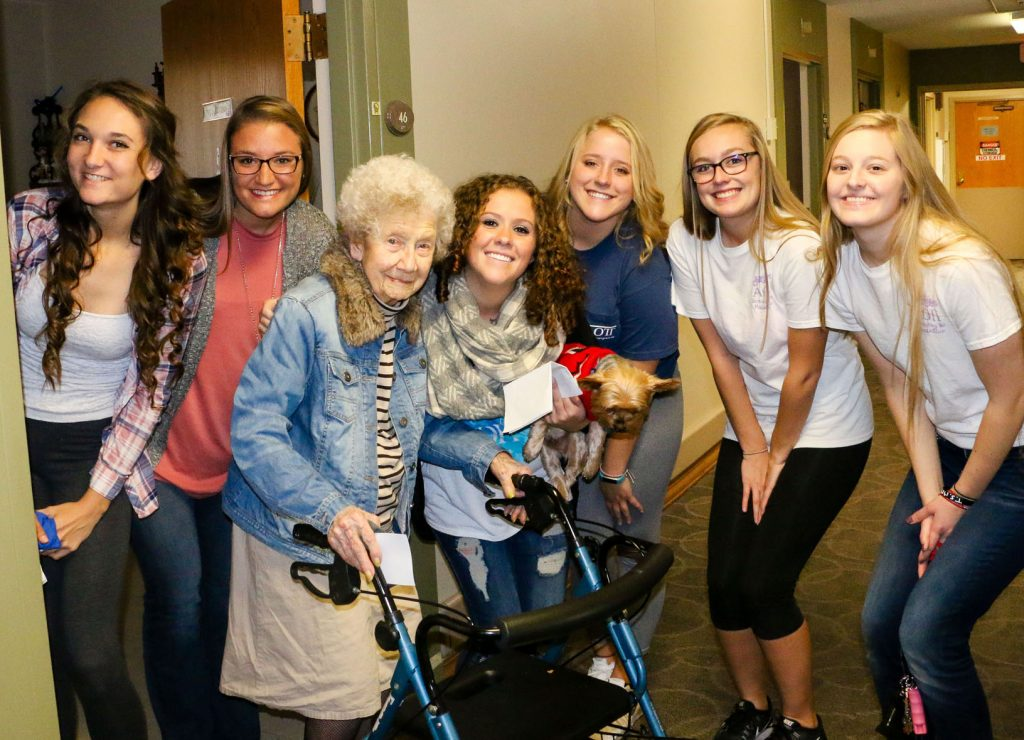 Members of Alpha Omicron Pi - Phi Sigma delivered homemade heat packs to residents of Mother Hull Home in Kearney Wednesday as part of Arthritis Awareness Week. (Photos by Amanda Andresen, UNK Communications)