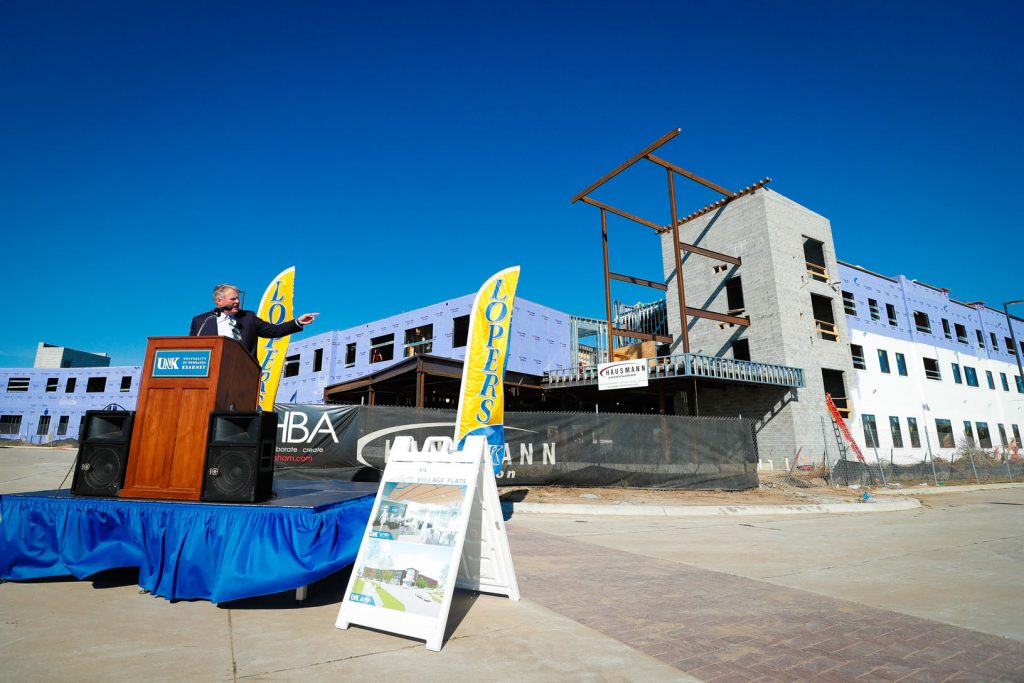 UNK Chancellor Doug Kristensen addresses the crowd at Wednesday's First Look event celebrating construction of the new $16 million, 130-bed Village Flats residence hall. (Photo by Corbey R. Dorsey, UNK Communications)
