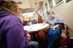 Sidney Graham of Shelton, left, conducts an interview with Delores Harm at the Cambridge Court senior living facility in Kearney. (Photo by Corbey R. Dorsey, UNK Communications)