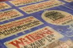 The Kearney Opera House curtain represents a time in history when local advertising was painted onto the canvas.