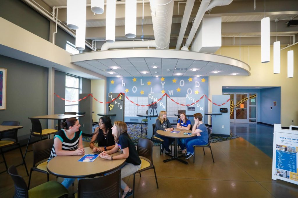 Students gather inside the lobby area of UNK's Randall and Mantor Halls. Students have high expectations of their campus living spaces, and UNK is always working to meet those needs, say UNK officials. (Photo by Corbey R. Dorsey, UNK Communications)