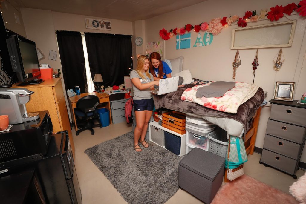 UNK students Morgan Keating, right, and Terra Newman share a laugh inside their room. UNK residence life staff offer a variety of events and other assistance to help with student success and keep them living on campus. (Photo by Corbey R. Dorsey, UNK Communications)