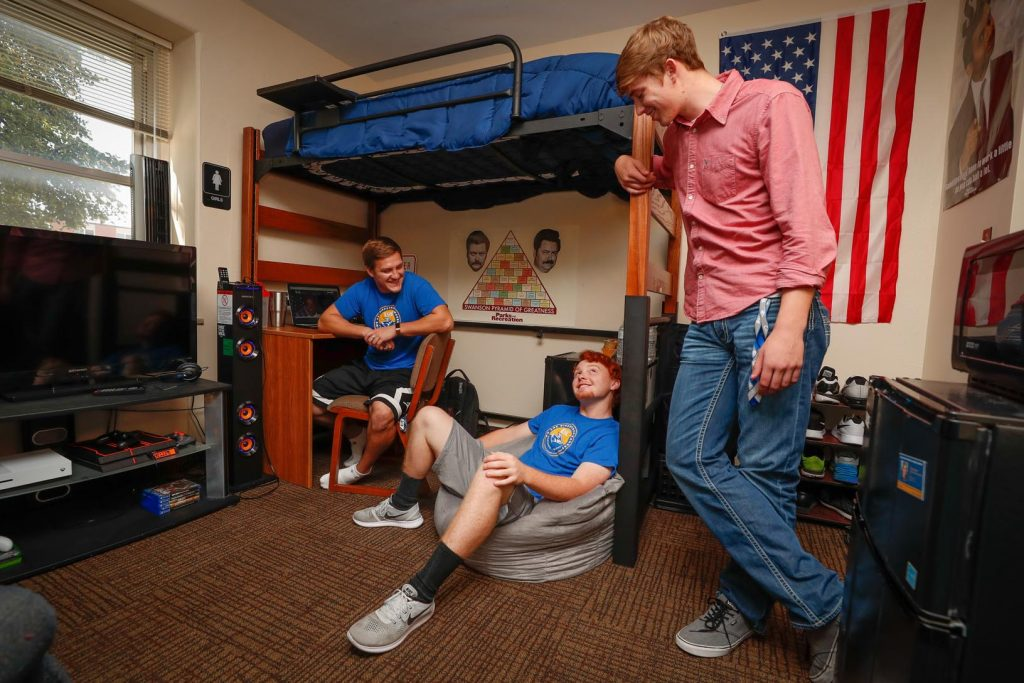 UNK students, from left, Joe Ferrero, Nick Kahlandt and Broc Stuhr hang out inside a residence hall. Living on campus helps students stay involved and avoid daily stresses that often come with renting, say UNK officials. (Photo by Corbey R. Dorsey, UNK Communications)