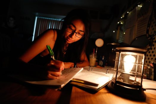 Student Alejandra Martinez studies inside her residence hall. UNK students who live on campus two or more years have higher grade point averages and a 69 percent greater chance of graduating in five years than those who don't, say officials. (Photo by Corbey R. Dorsey, UNK Communications)