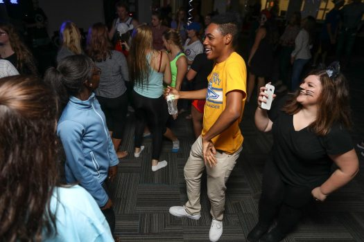 Students dance at the 2016 Fall Ball hosted by UNK's Office of Residence. UNK hosts a foam party, movie and bingo nights, bowling, laser tag, donut hole eating contest, ice skating and many other events to entertain students. (Photo by Corbey R. Dorsey, UNK Communications)