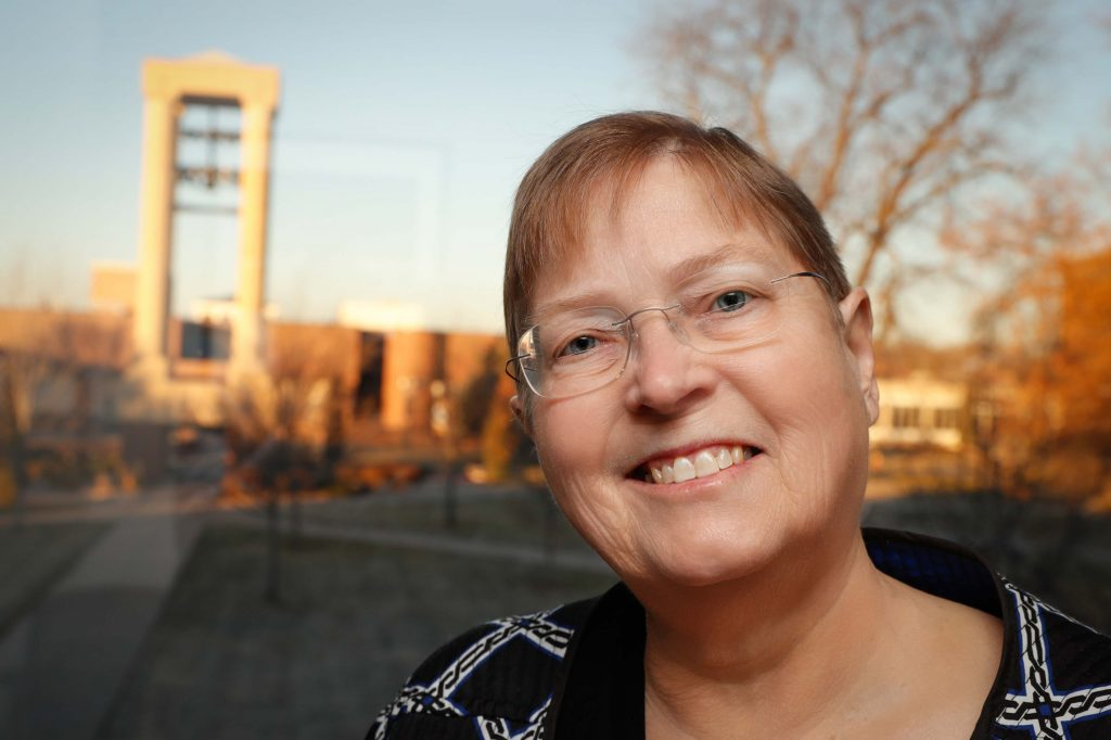 "Kathy Livingston is retiring this month at working 38 years UNK. ""My first office at UNK sat close to where the Bell Tower is today. It was located in a hallway that led to the condemned auditorium attached to the original Administration Building. ... My office today provides a spectacular view of the campus, which invigorates me on days when I need it."" (Photo by Corbey R. Dorsey, UNK News)"
