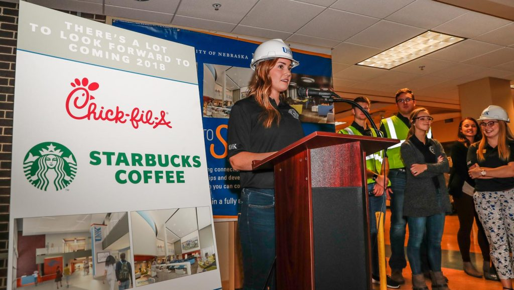 UNK students Tuesday evening celebrated the start of renovations in the Nebraskan Student Union, which will include a new Chick-fil-A restaurant and Starbucks. Work starts soon on the $6 million improvements, which also include new interior finishes and furniture, more open spaces, a new student lounge, and improved HVAC, lighting and other infrastructure. Student Stephanie Paulsen, at podium, speaks to those attending the event.