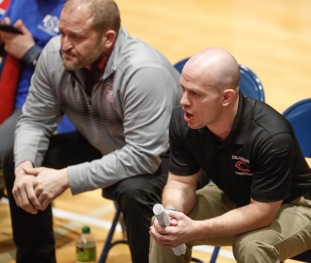 """Columbus High coach Adam Keiswetter was among several coaches with UNK ties who brought their teams to the dual championships at UNK. He noted facility changes since his time as a Loper, including banners representing UNK's wrestling national championships and five national runner-up performances. """"It's kind of cool to see that stuff. The new athletic director has really upgraded this facility,"""" Keiswetter said of Paul Plinske, who was named director of athletics at UNK in 2013."""