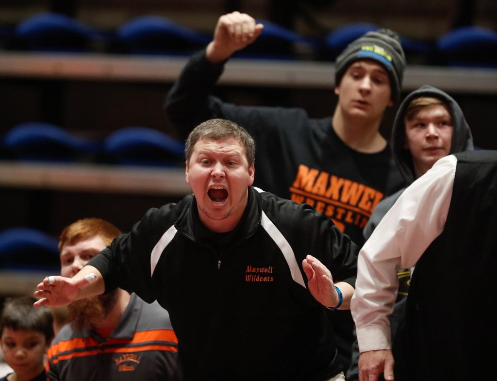 Maxwell coach Ryan Jones yells instructions to one of his wrestlers at Saturday's NSAA Dual Wrestling Championships. The University of Nebraska at Kearney has hosted the event since 2013. (Photo by Corbey R. Dorsey, UNK Communications)