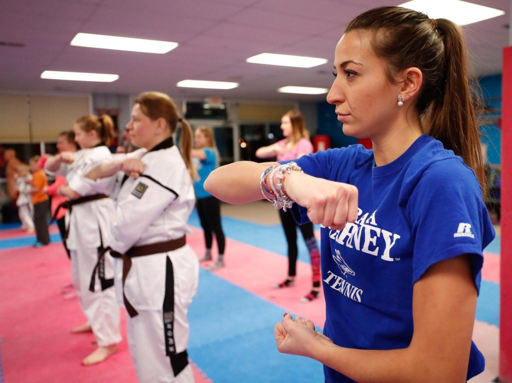 University of Nebraska at Kearney ad campaigns student Paula Jimenez takes part in a self-defense class at Nebraska School of Martial Arts. Students sat in on a class to learn more about the business and get a better feel for their client. (Photo by Corbey R. Dorsey, UNK Communications)