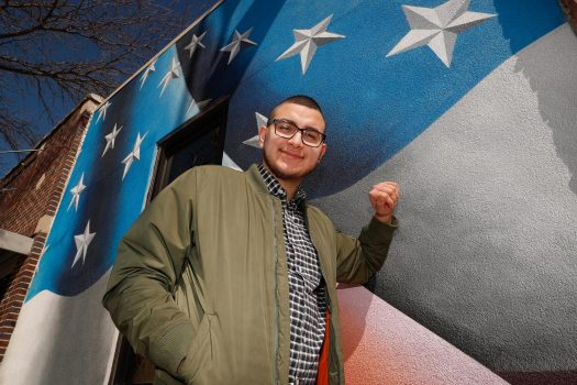 UNK alumnus Josh Arias has helped create a number of public murals in central Nebraska, including the American flag on the Kearney VFW Club at 2215 First Ave. (Photo by Corbey R. Dorsey, UNK Communications)